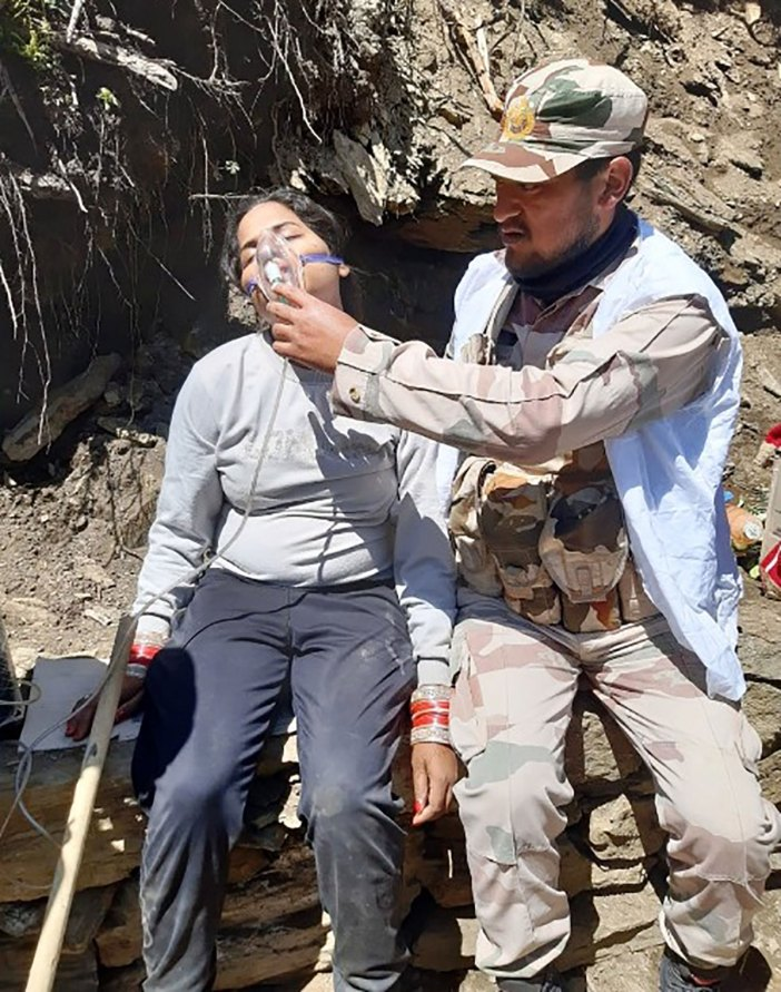 ITPB personnel offering oxygen to the pilgrims suffering from breathing issues over the heights to Amarnath cave. Pic-ITBP