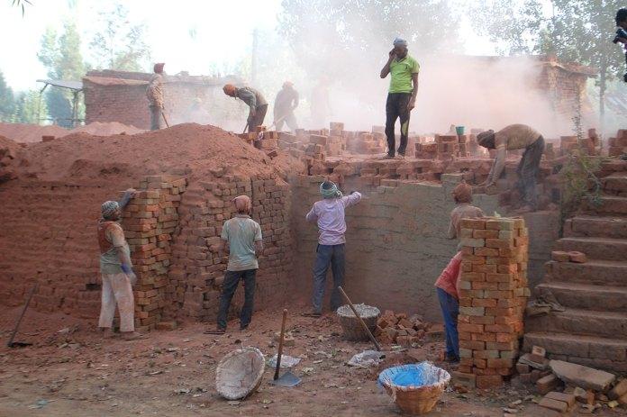 Workers on the job at a brick klin somewhere in district Budgam. KL Image: Bilal Bahadur
