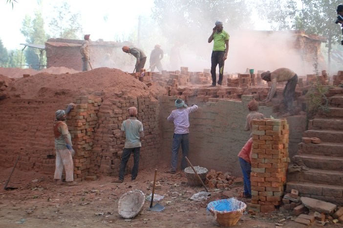 Workers on the job at a brick klin somewhere in district Budgam. KL Image: Bilal Bahadur