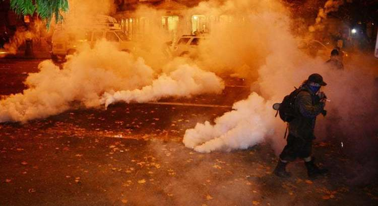 Protests against president-elect Trump tear-gassed in US