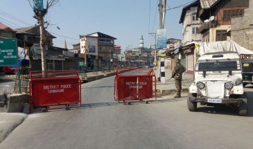 IN PICS: Kashmir shuts down to protest army killings of 2 Shopian youth