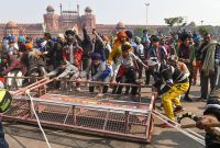 Farmers Storm Into Barricaded Delhi, Hoist Flag On Red Fort