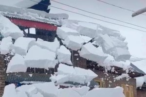 Woman Dies After Coming Under Snow From Rooftop