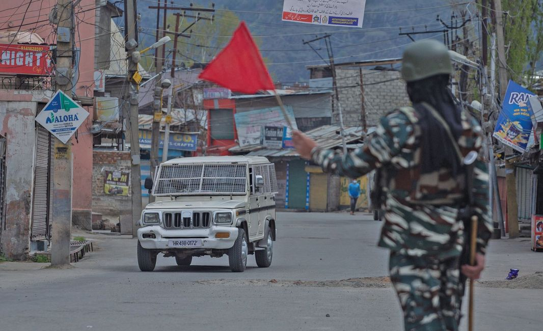Red zone: CRPF person waves a red flag as he signals security vehicle to turn back