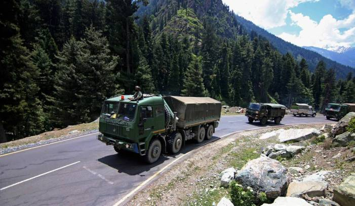 Army soldiers ride in a convoy along a highway leading towards Leh, bordering China