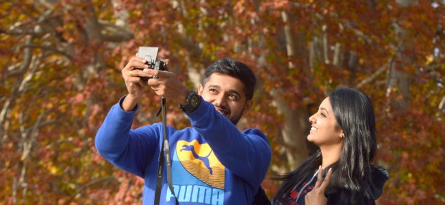 A tourist couple clicking selfie at Nishat Bagh on Friday  -KV Photo