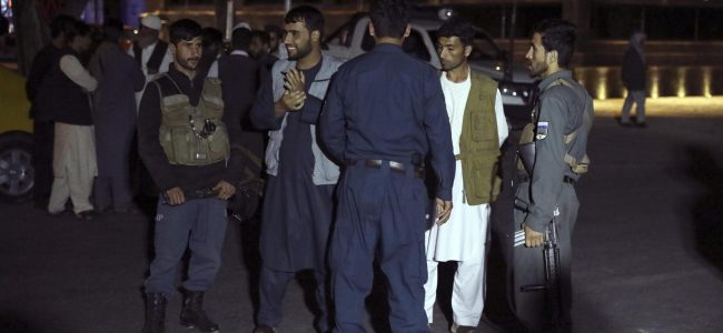 Suicide truck bomber hits Afghan guest house, killing 14