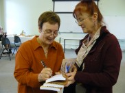 Judy McKinty and Ceridwen Masiulanis signing copies