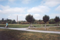 Bike paths, apple orchards, and meadows with the furnaces in the background.