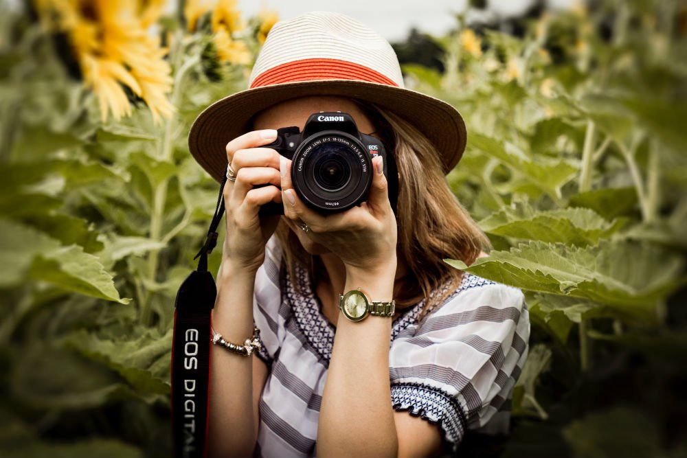 woman holding a camera towards the viewer