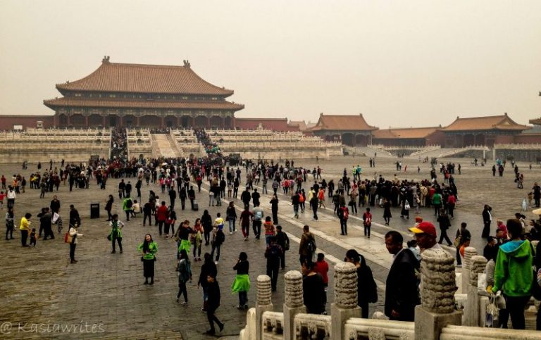 people in a large plaza inside the forbidden city