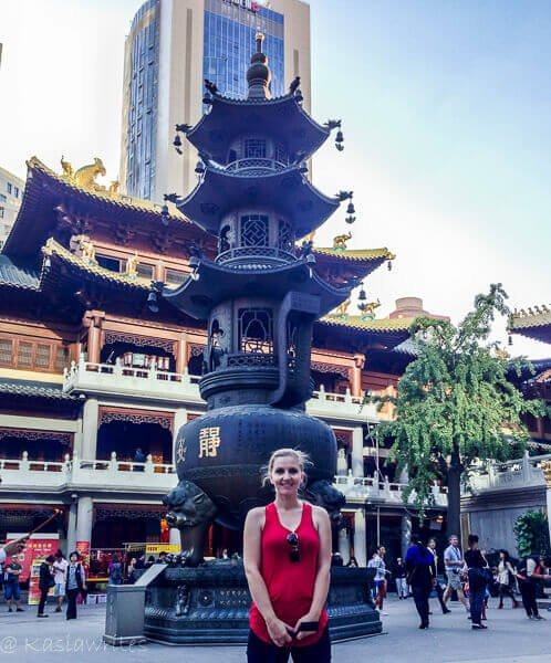 woman in red top in chinese temple courtyard