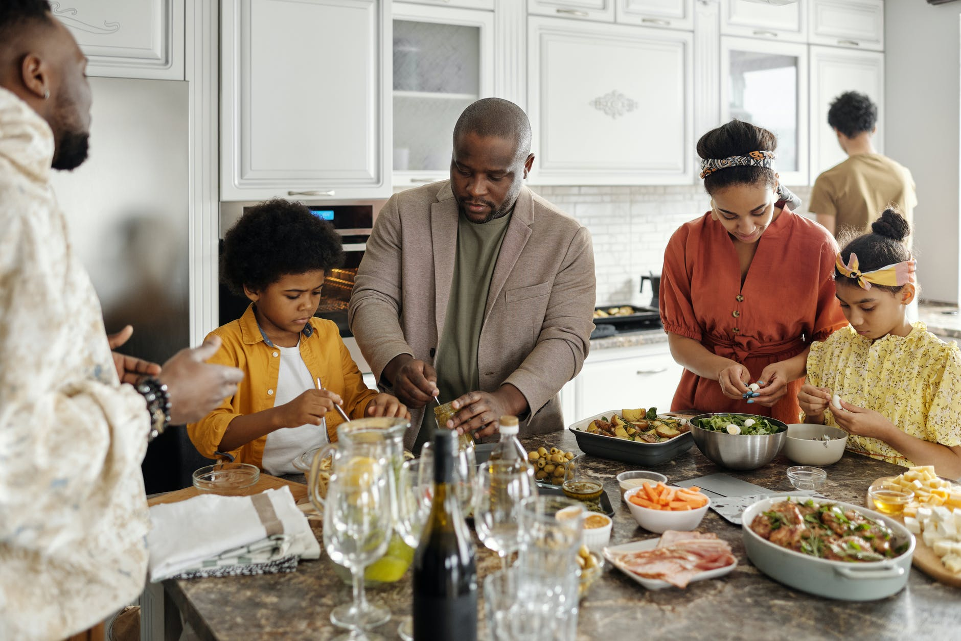 family preparing food in the kitchen