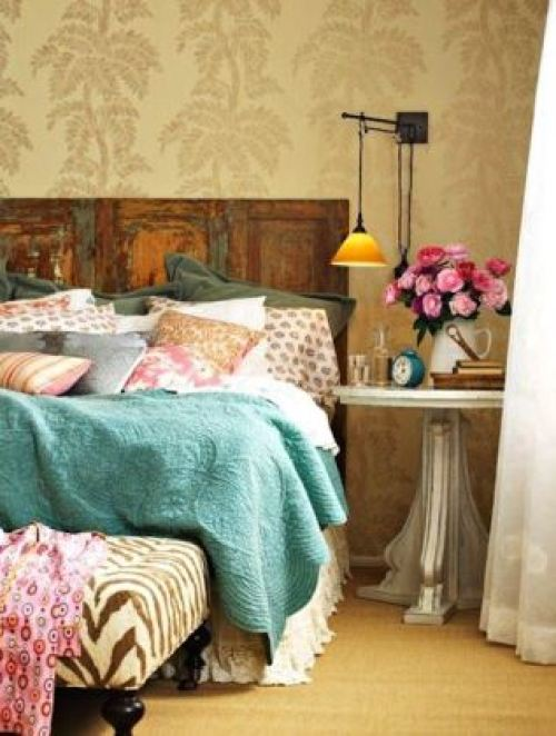 Vintage Styling Tips - reclaimed materials - distressed door as headboard via Your Vintage Life by Kate Beavis