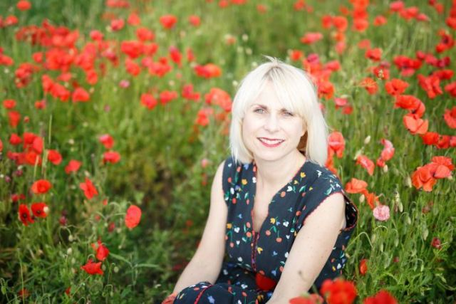 kate Beavis in a poppy field in Hitchin photographed by Sharon Cooper