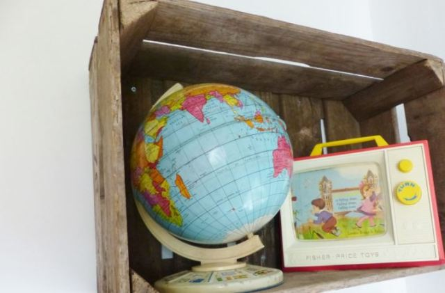 A vintage children's room by Kate Beavis.com, vintage globe and fisher price tv