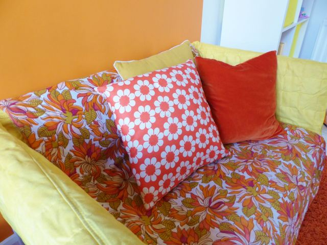 A vintage children's room by Kate Beavis.com, vintage orange and yellow cushions