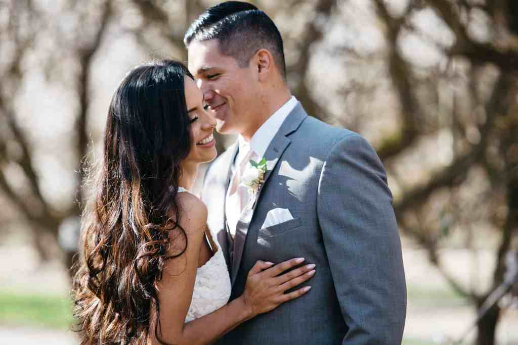 bride and groom in almond orchard wedding inspiration