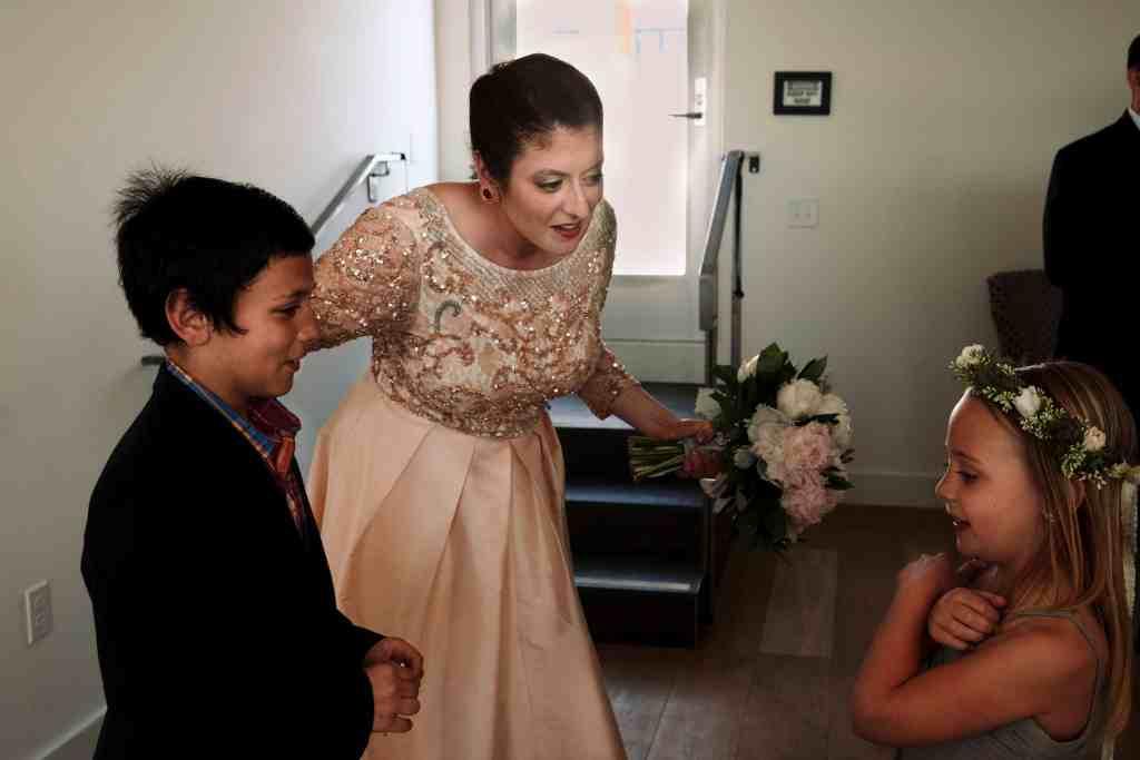 bride greeting bridesmaid at unique wedding venue