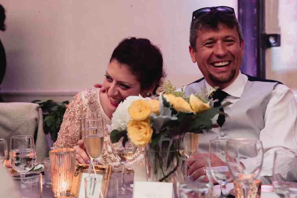 bride and groom during speeches at unique wedding venue