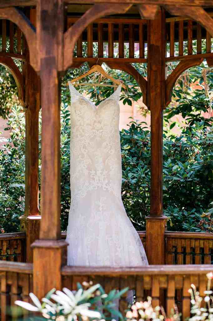 Wedding dress hanging in a gazebo