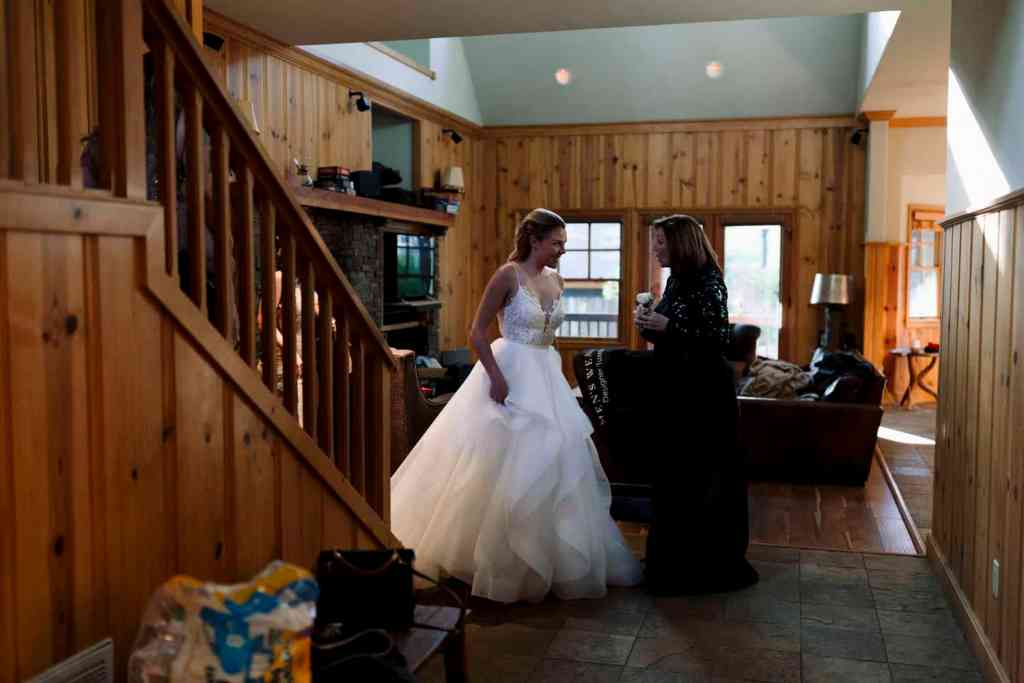 bride in lake house in mountains