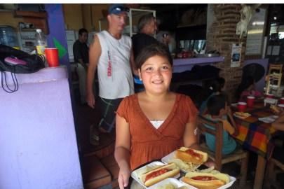 Lizet serves hot dogs