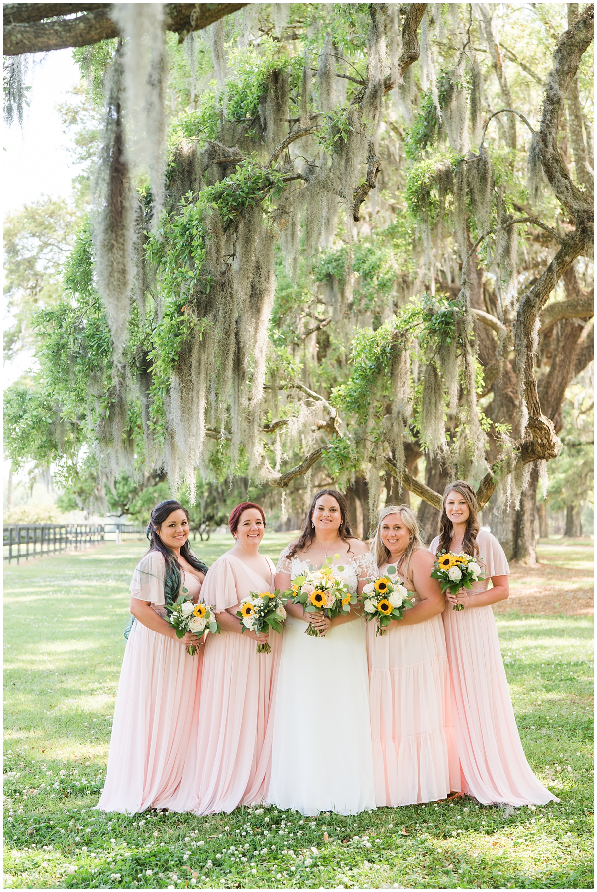 bride and bridesmaids in pink pose before Boone Hall wedding