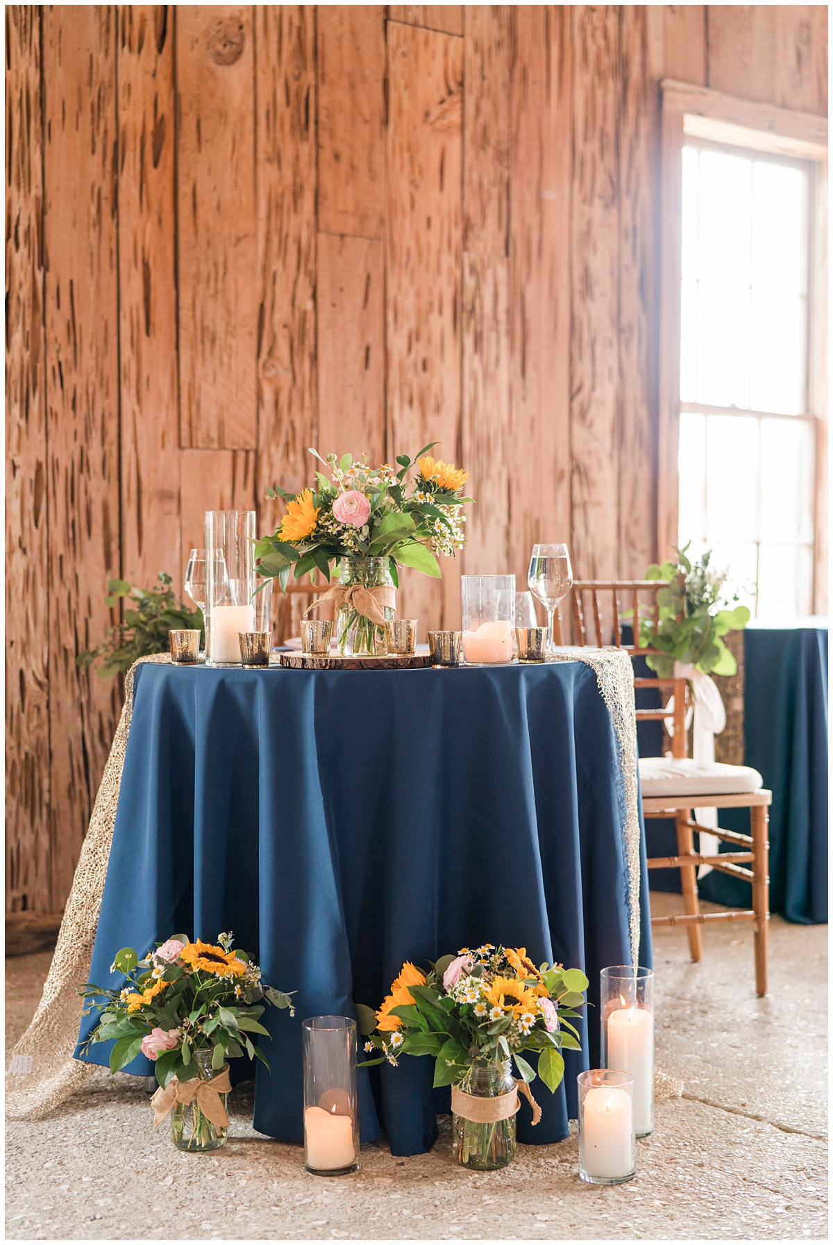 sweetheart table with sunflower centerpieces