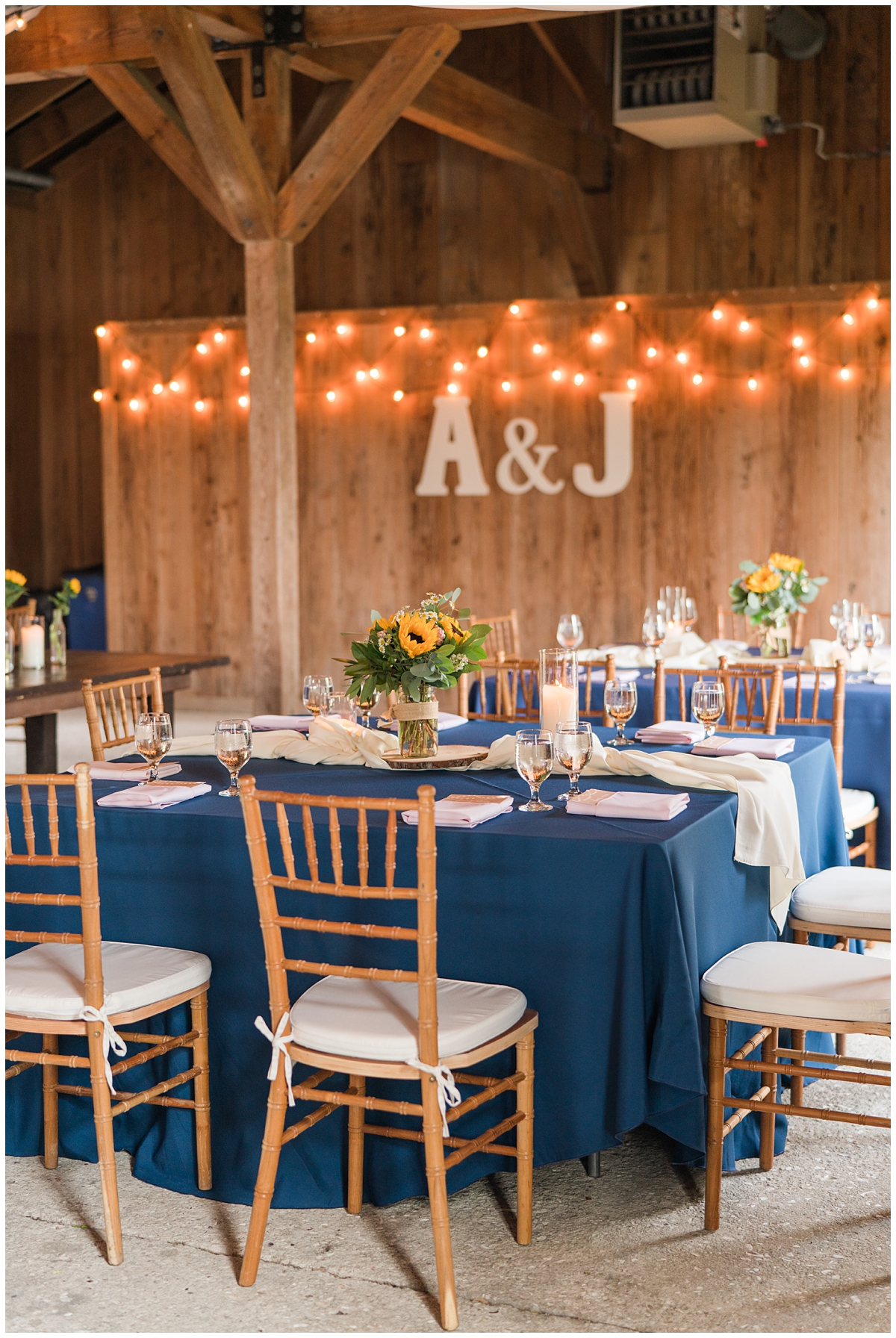 wedding reception with navy table clothes and sunflower centerpieces at Boone Hall
