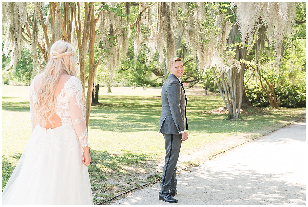 groom turns to look at bride during Cannon Green wedding day first look