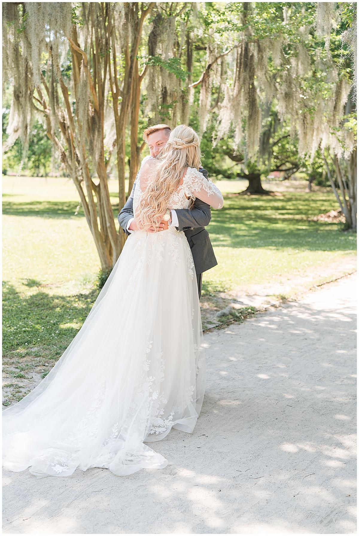 newlyweds hug during first look in Charleston SC