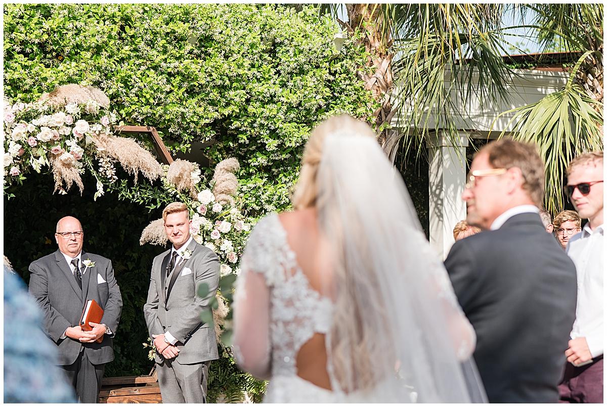 bride walks down aisle at Cannon Green