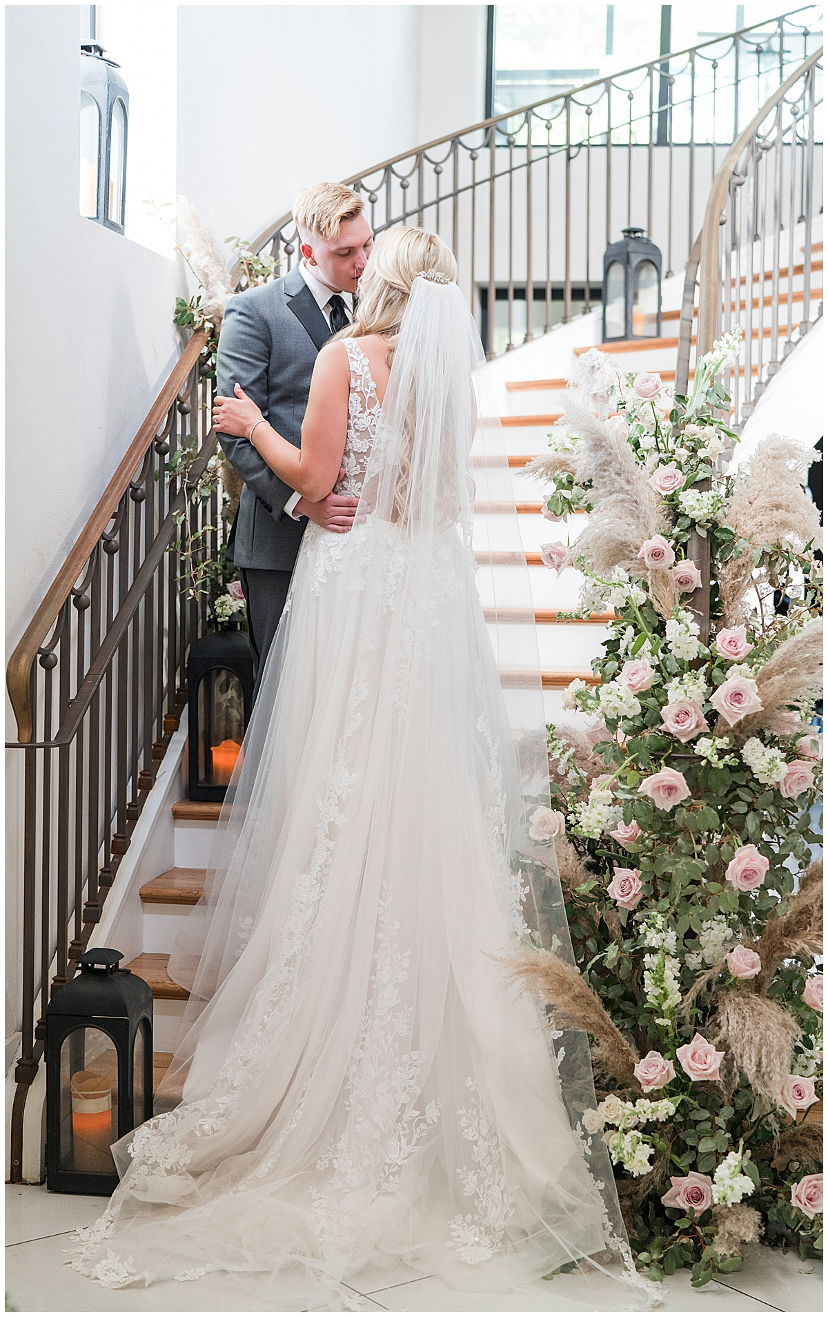 bride and groom kiss on steps inside Cannon Green