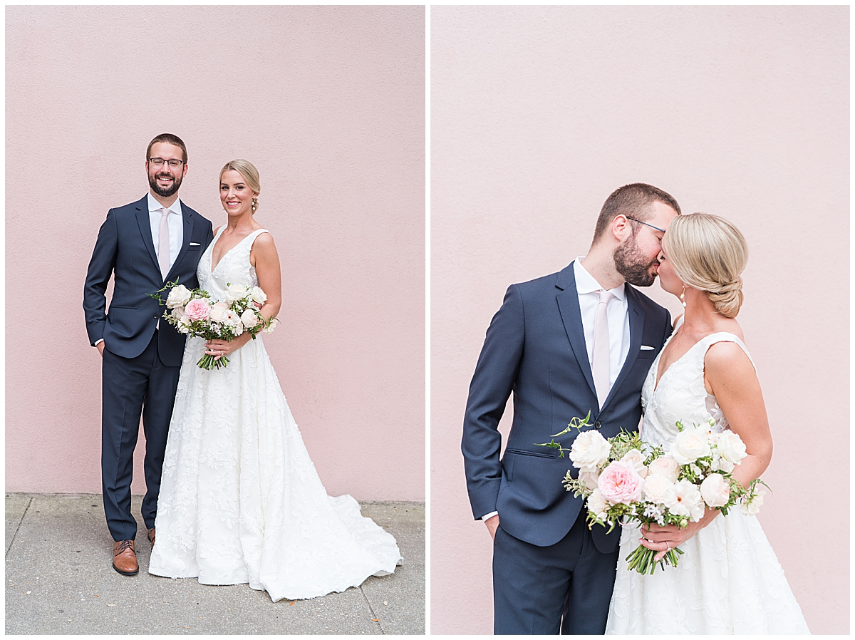 bride and groom kiss by pink house in Charleston SC