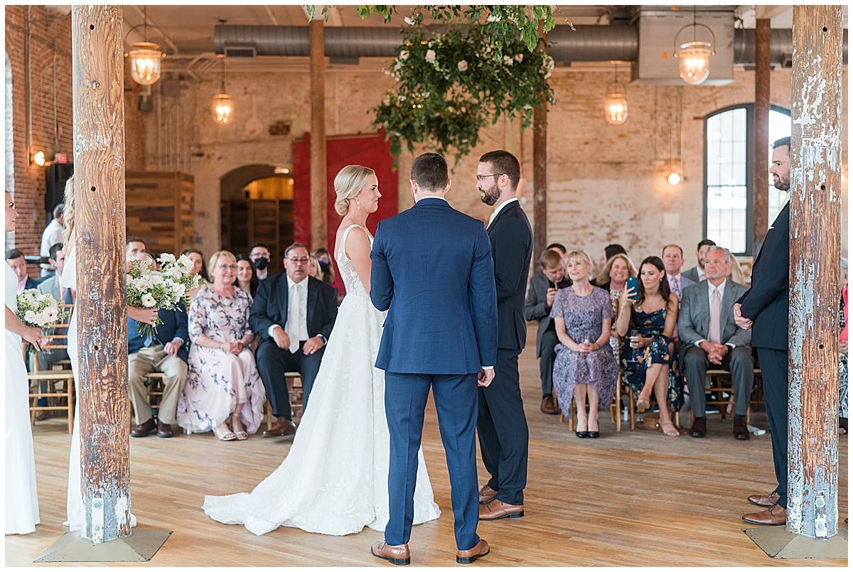 bride and groom exchange vows during Cedar Room Charleston wedding