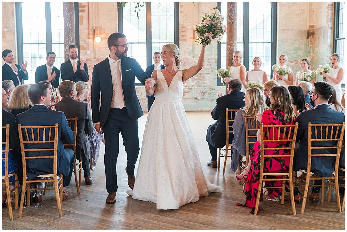 newlyweds cheer leaving ceremony at Cedar Room