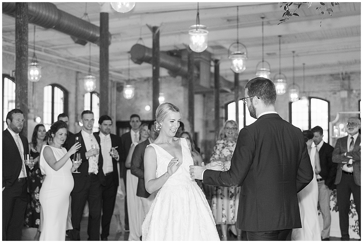 bride and groom dance together in Charleston