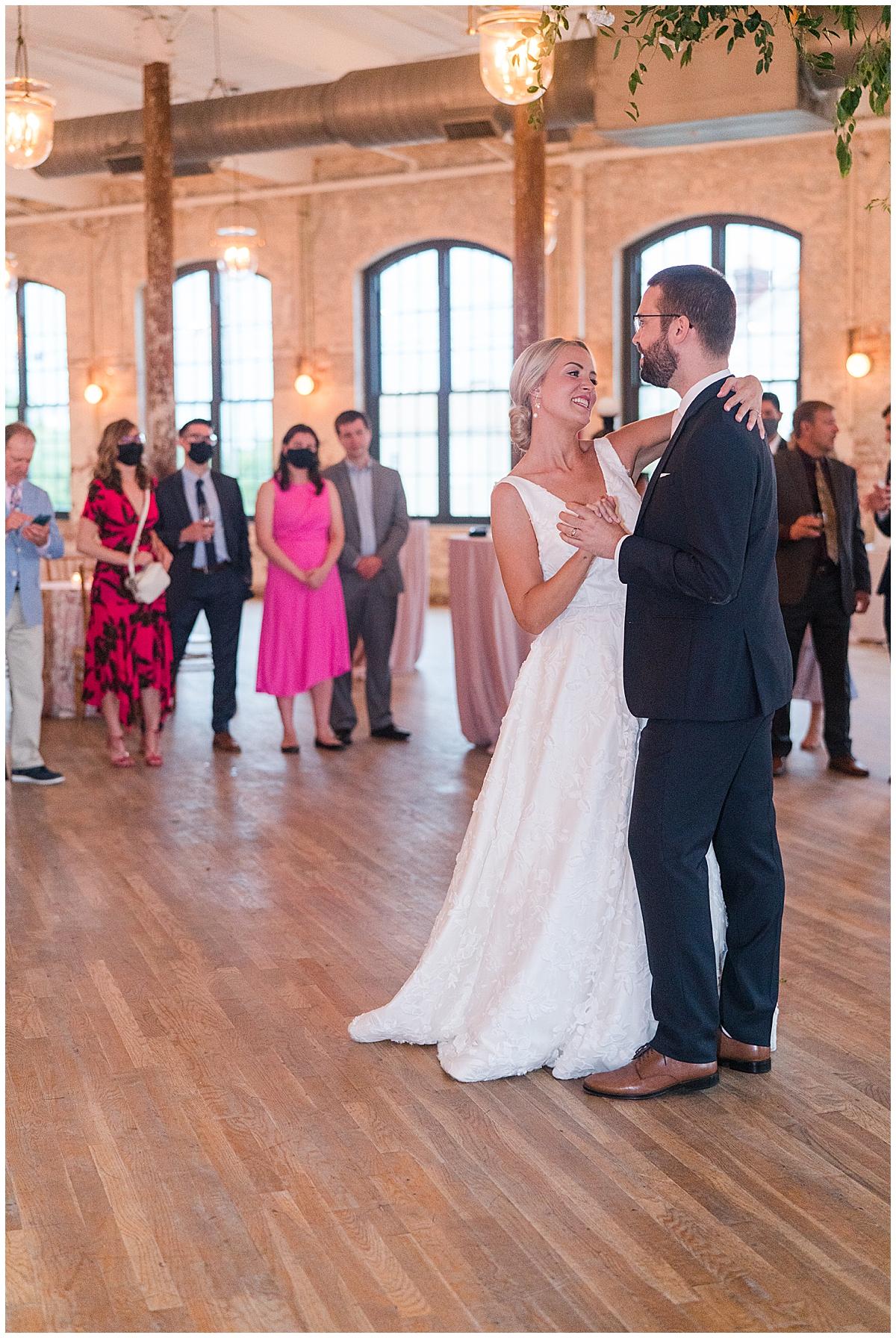 bride dances with groom at Cedar Room wedding reception