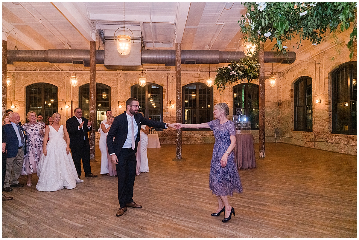 groom and mother dance during Cedar Room Charleston wedding reception