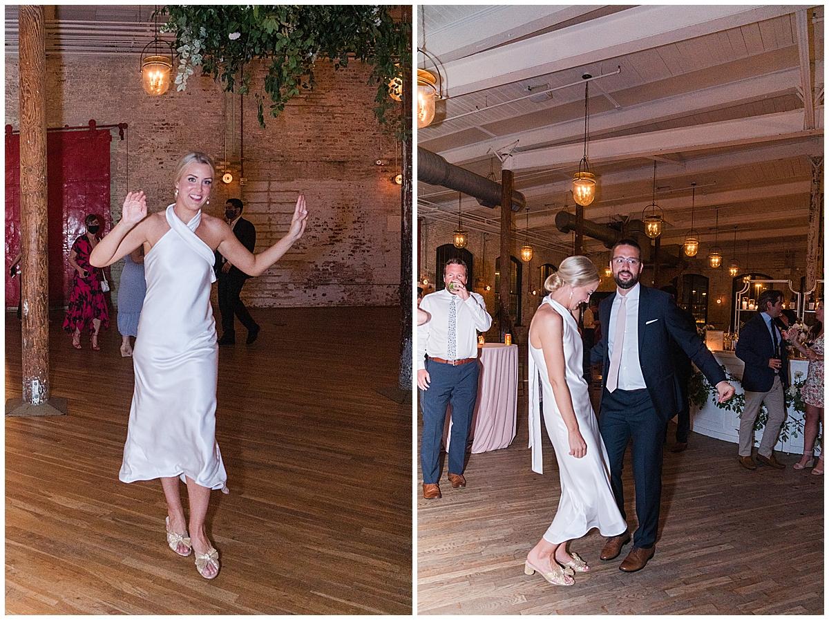 bride walks into reception after dress change