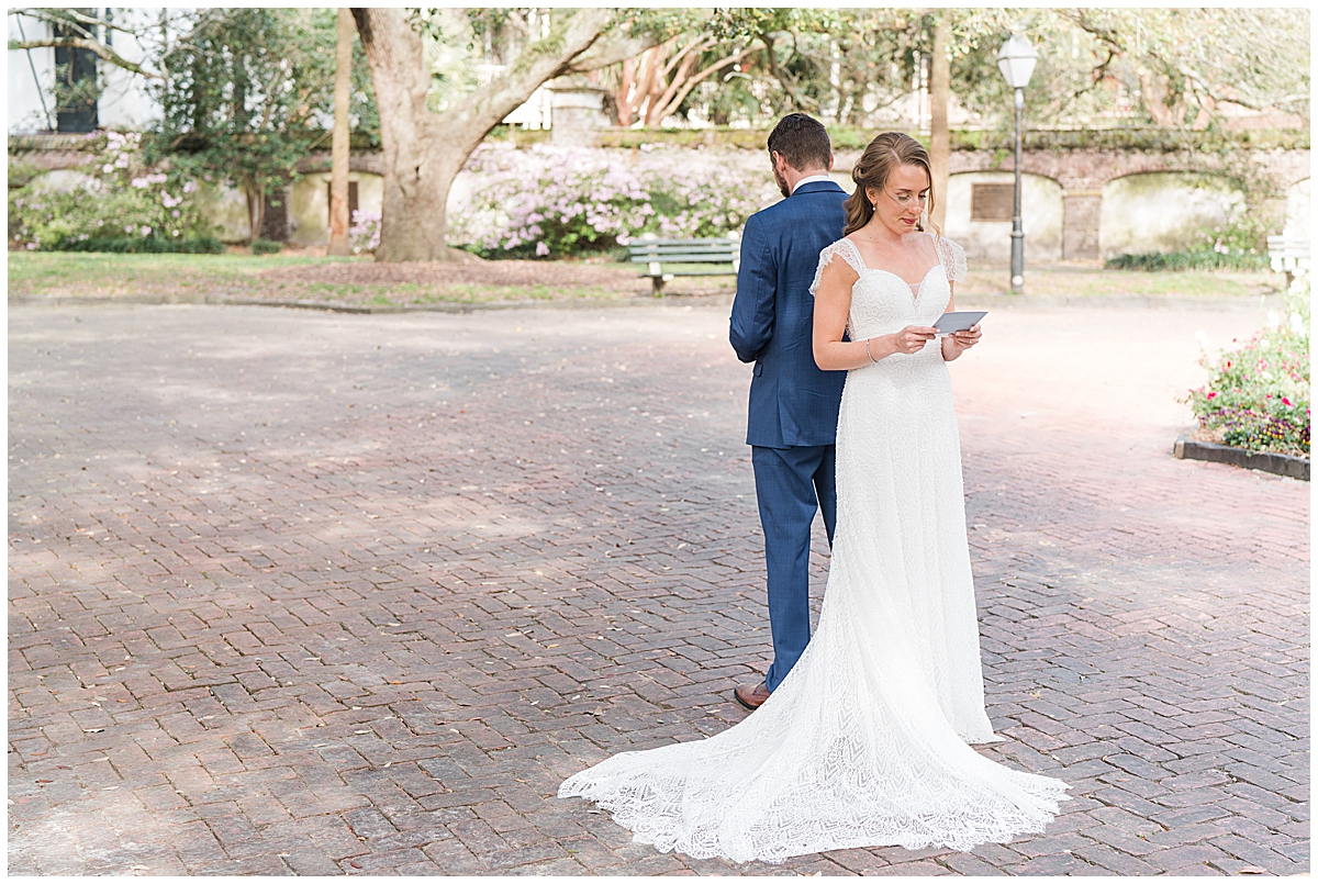 first look in Charleston park for bride and groom