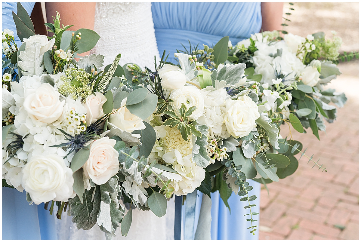 bride and bridesmaids hold ivory bouquet