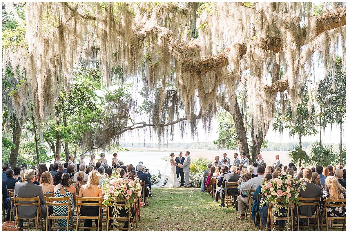 Runnymeade Plantation Charleston wedding ceremony under tree with Spanish moss