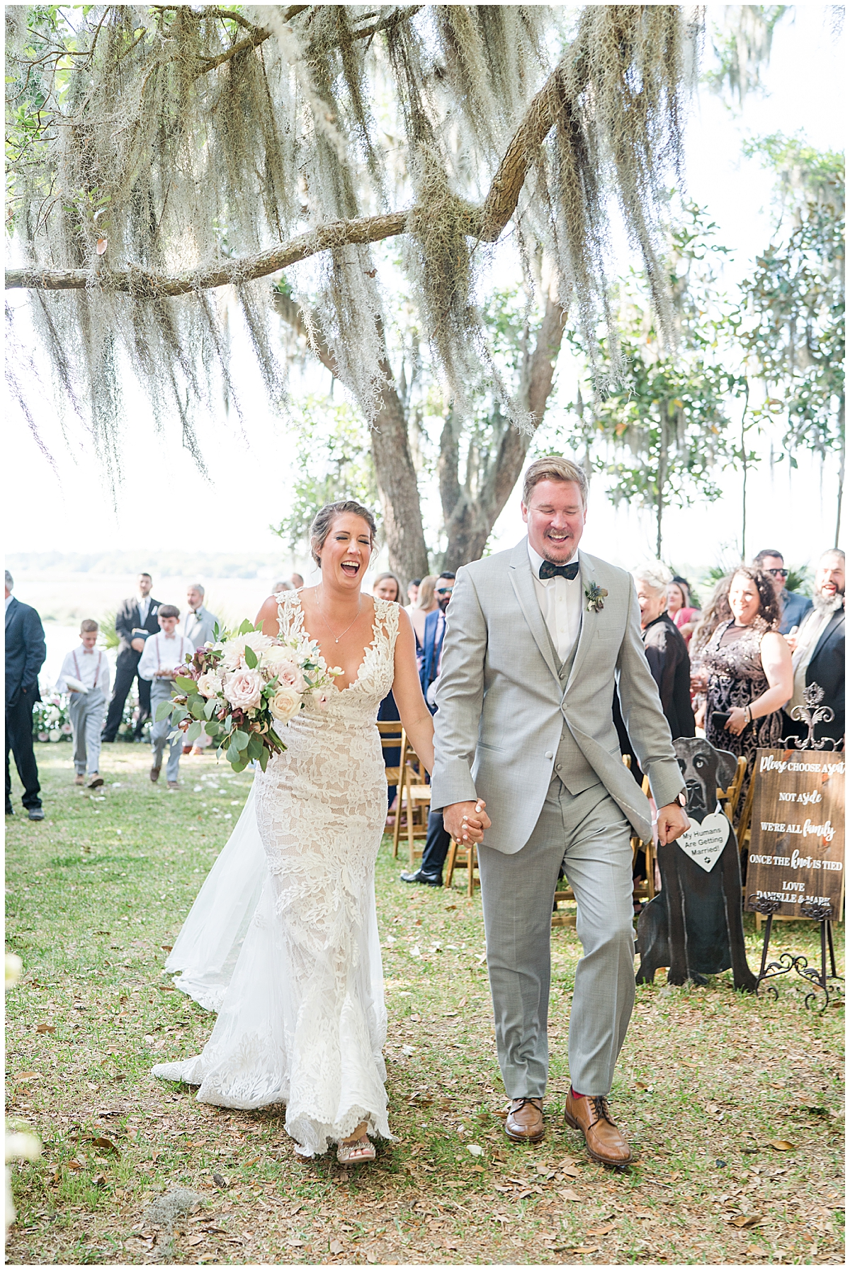 couple walks up aisle after Runnymeade Plantation Charleston wedding ceremony
