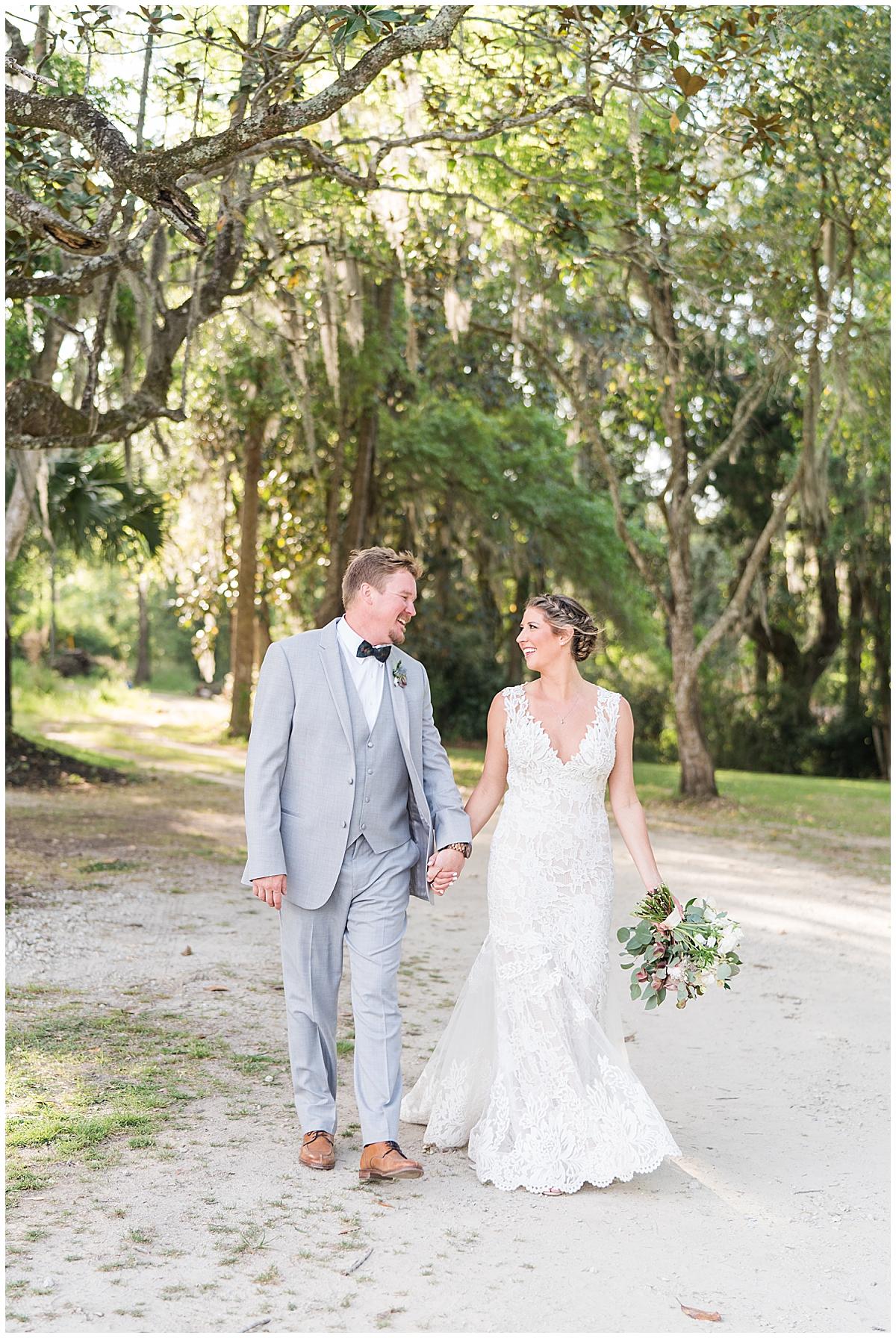 bride and groom walk through Runnymeade Plantation