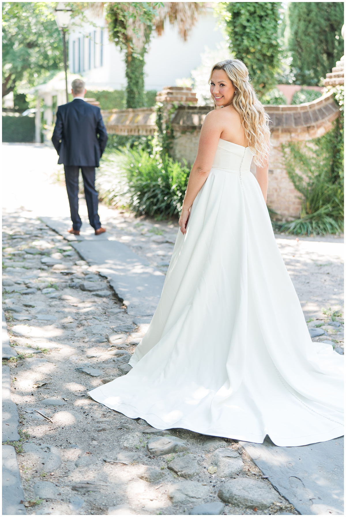 bride approaches groom for first look on Charleston wedding day