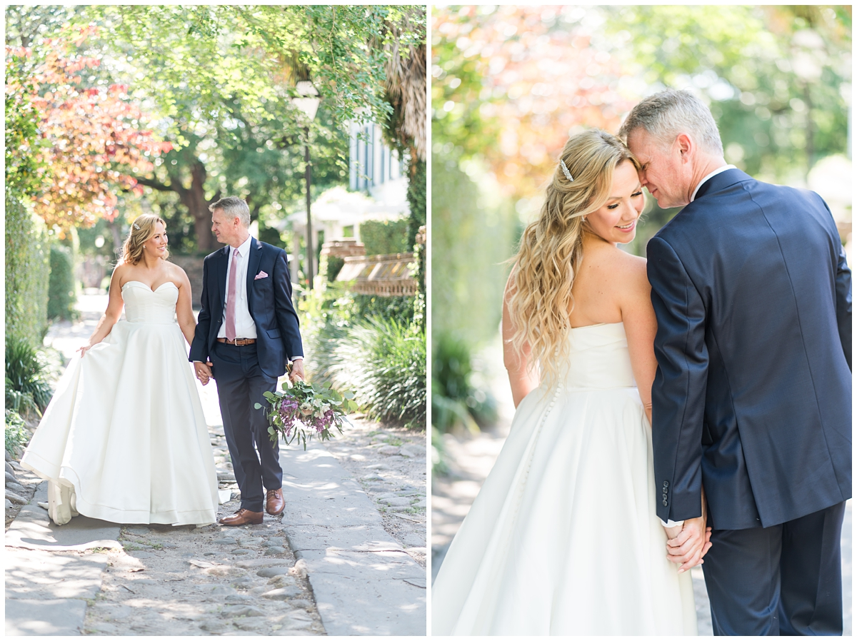 bride and groom hold hands walking through SC streets