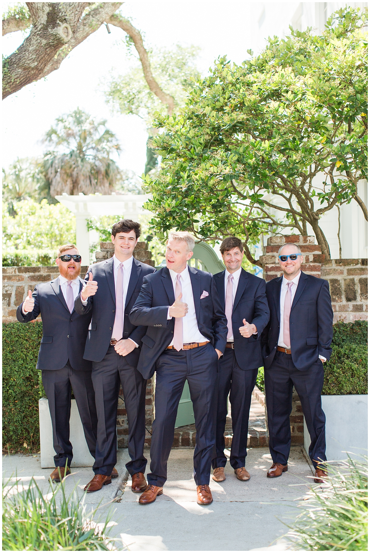 groom poses with funny pose for groomsmen