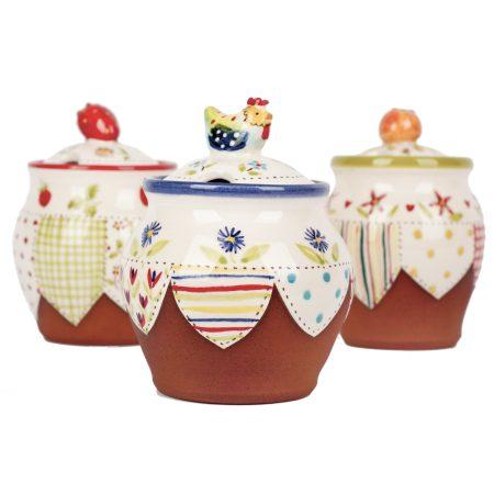 A photo of three handmade ceramic Small floral lidded jars